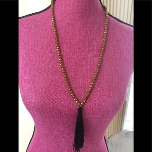 Glass multi facet bead and tassel necklace
